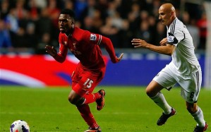 PRINCIPAL ACTORS: Daniel Sturridge (L) scored his fourth goal in as many matches. He is chased by ex-Red Jonjo Shelvey, at the heart of all four goals in the 2-2 draw at Swansea's Liberty Stadium. (http://i.telegraph.co.uk/)